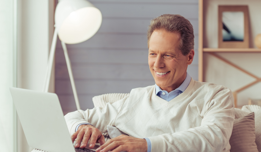 Man looking at computer smiling